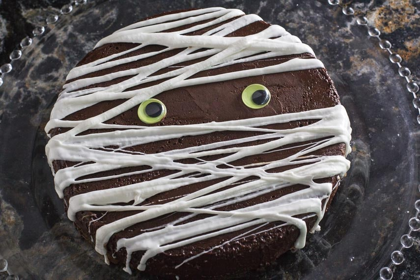 mummy decoration on low FODMAP 3 Ingredient flourless chocolate cake