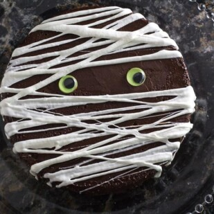overhead image of Flourless chocolate cake with Mummy decoration