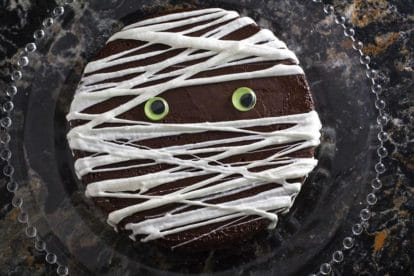overhead image of Flourless chocolate cake with Mummy decoration