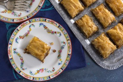 overhead image of low FODMAP walnut baklava on decorative plate and also on serving platter