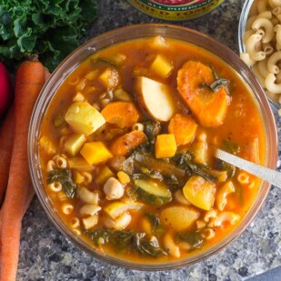 overhead of Low FODMAP Vegetable, Pasta & Bean Soup with ingredients
