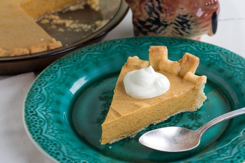 overhead view of low FODMAP pumpkin chiffon pie on a green plate