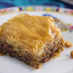 piece of low FODMAP walnut baklava on decorative late, closeup