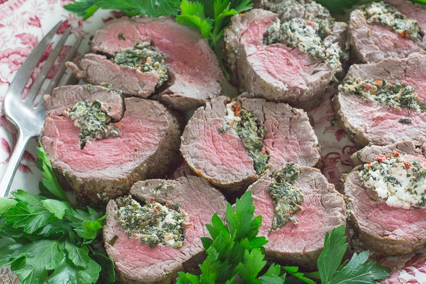 platter of Beef Tenderloin Stuffed with Goat Cheese, Spinach & Sun-Dried Tomatoes