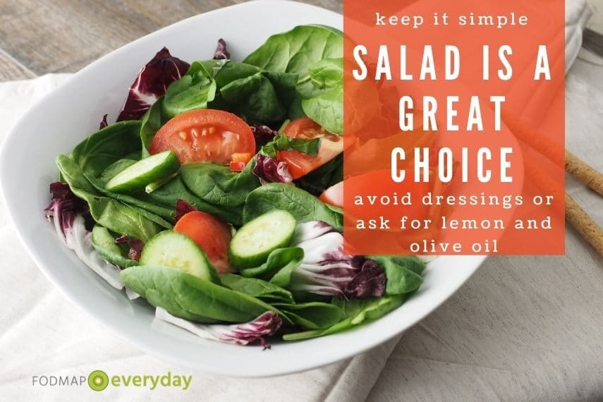 """close up of a bowl of salad with the words """"salad is a great choice"""""""