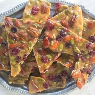 Spiced Fruit & Nut brittle piled onto a silver tray