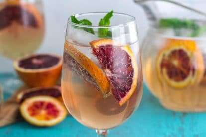 closeup of Low FODMAP Blood Orange Ginger Mint Spritzer in a clear glass