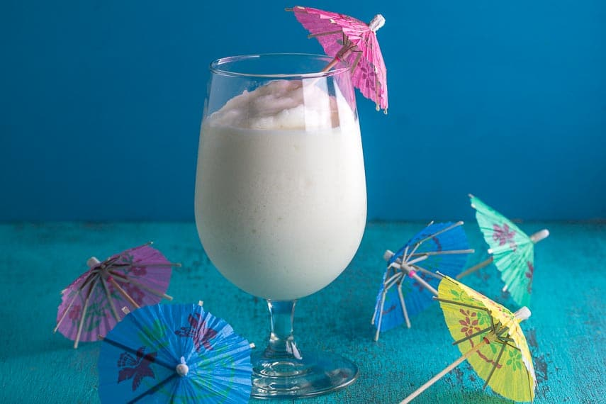 frosty low fodmap pina colada with paper parasols