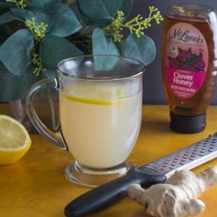 low FODMAP honey lemon ginger tea in a glass mug