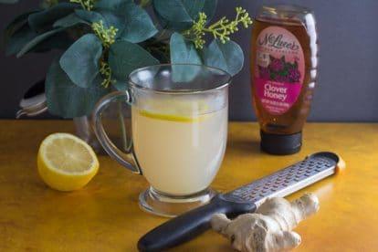 low FODMAP honey lemon ginger tea in a glass mug