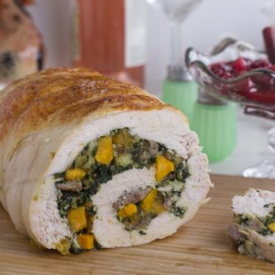 interior shot of Low FODMAP Kale & Butternut Squash Stuffed Turkey Breast on a cutting board_