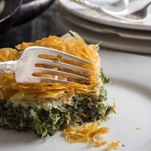 low FODMAP Spanakopita Spinach Pie closeup on white plate