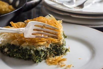low FODMAP Spanakopita Spinach Pie closeup on white plate
