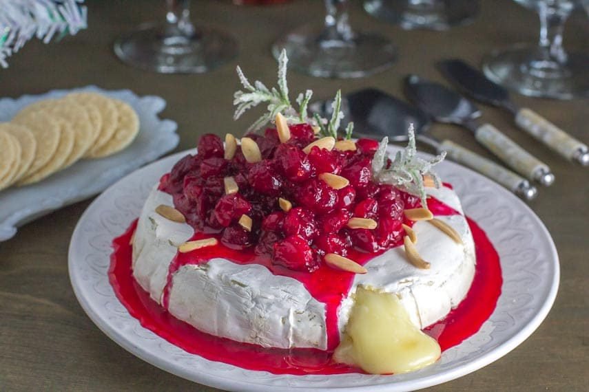 low fodmap baked brie with cranberries; cheese oozing