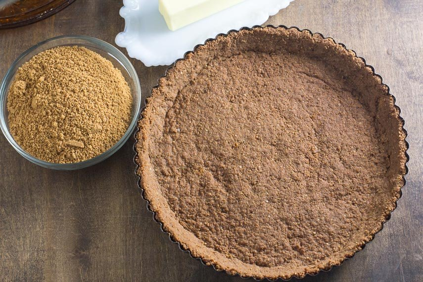 overhead image of a pre-baked low FODMAP crumb crust in a tart pan