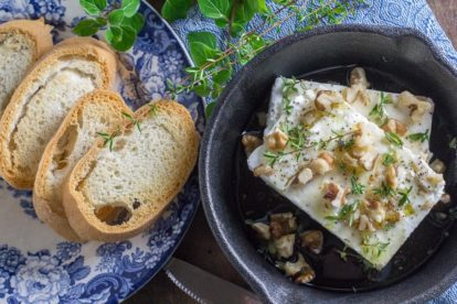 overhead image of low FODMAP Baked Feta with Honey, Walnuts & herbs
