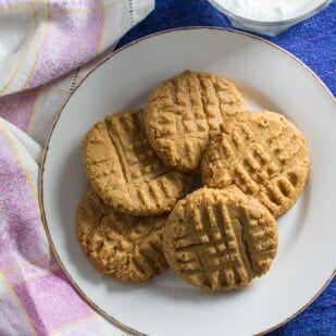overhead image of one-bowl peanut butter cookies on white plate