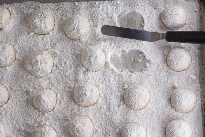 overhead image of pecan butterballs on baking pan