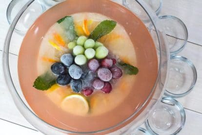 overhead image of punch bowl filled with Low FODMAP Fruited Lemonade Rosé Punch