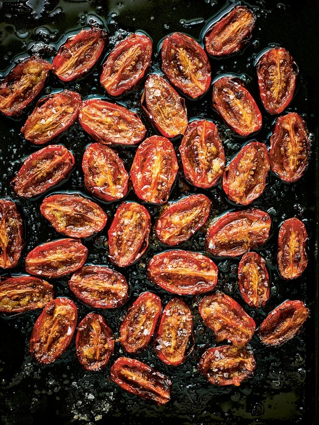 oven dried tomatoes against a dark background