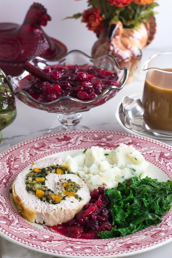 vertical image of Low FODMAP Kale & Butternut Squash Stuffed Turkey Breast on a plate