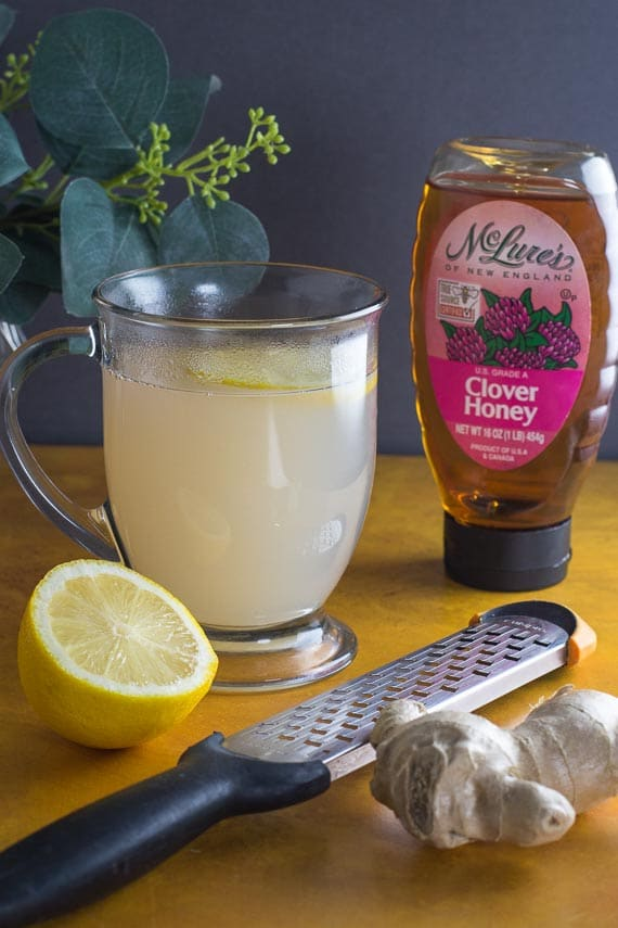 vertical image of low FODMAP honey lemon ginger tea