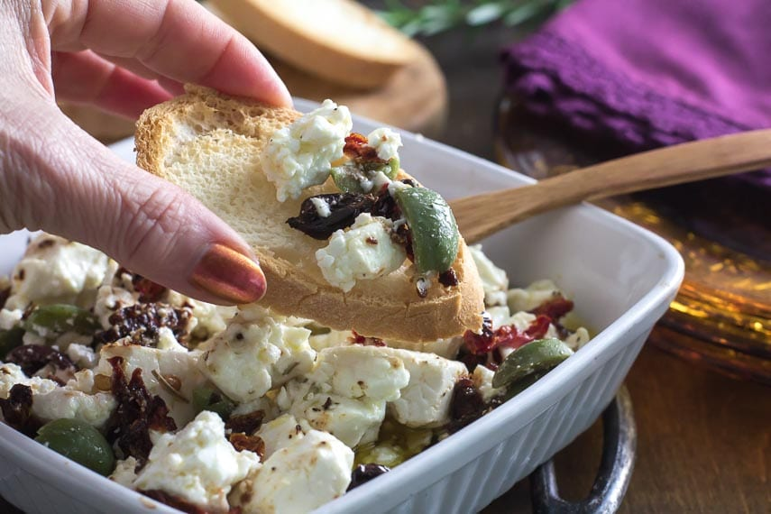 Baked Feta with Olives and sundried tomatoes on a baguette