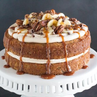 horizontal image of low FODMAP Salted Caramel Banana Cake on white pedestal