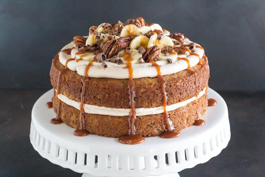 horizontal image of low FODMAP Salted Caramel Banana Cake on white pedestal