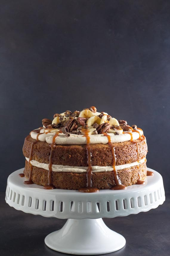 long shot, vertical of low FODMAP Salted Caramel Banana Cake on pedestal