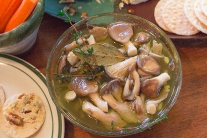 overhead image of easy low FODMAP marinated mushrooms in a glass bowl