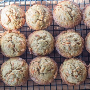Low FODMAP Banana Carrot Chia Corn Muffins, on cooling rack in sunlight