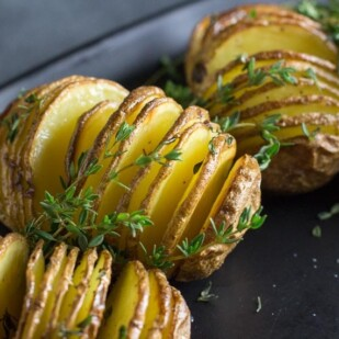 closeup low FODMAP hasselback potatoes with garlic and thyme