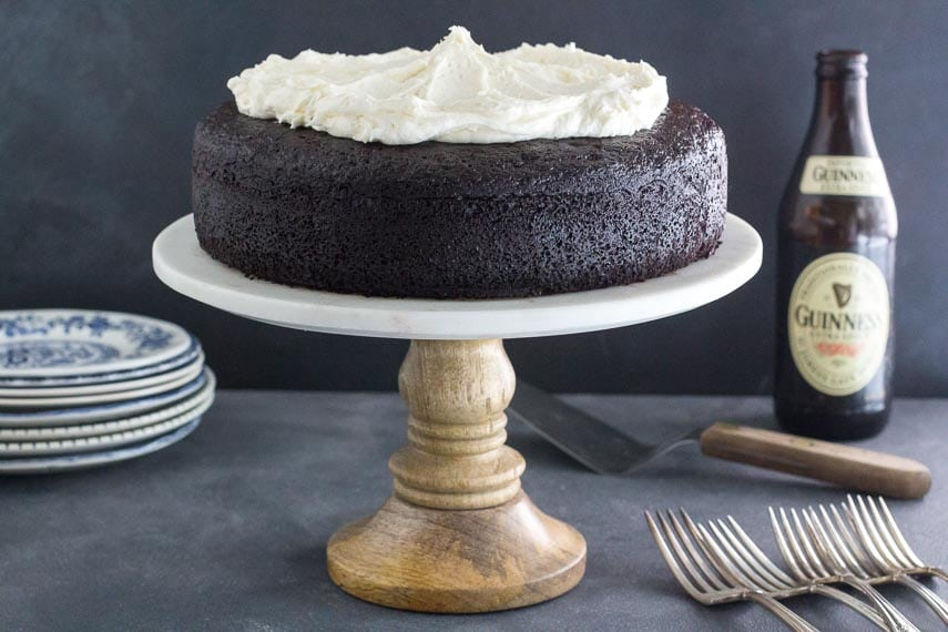 low FODMAP Black Velvet Chocolate Guinness cake with Whiskey Frosting on rustic pedestal