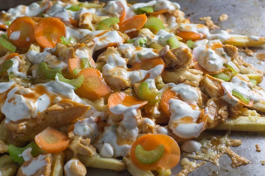 low FODMAP Buffalo Chicken Fries closeup on sheet pan