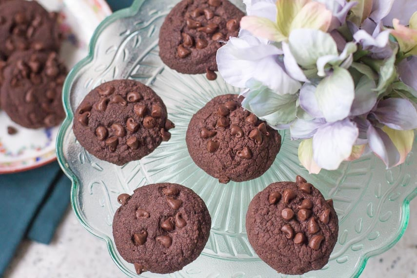 low FODMAP double chocolate shortbread cookies on colored glass plate