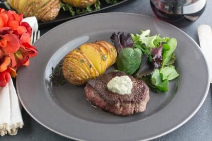 low FODMAP filet mignon medallions with blue cheese compound butter; hasselback potatoes on the side