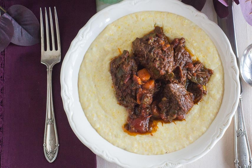 AP short ribs with rosemary and orange on polenta in white bowl