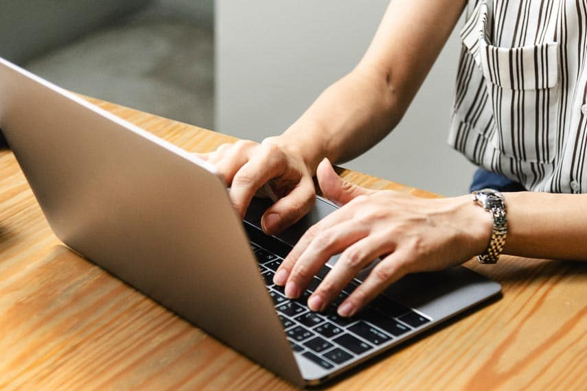 How Are Low FODMAP Recipes Created? typing on laptop