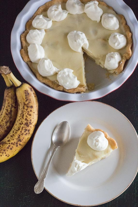 vertical overhead view of banana cream pie with ripe bananas