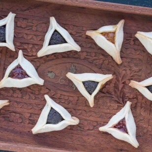 overhead shot of low FODMAP Gluten-Free hamantaschen on wooden tray