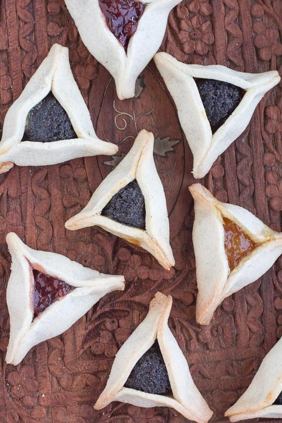 vertical image of low FODMAP Gluten-free hamantaschen on wooden platter
