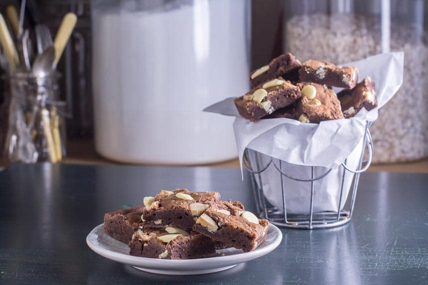 low FODMAP black & white brownies in basket and on a plate and in a basket