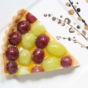 wedge of Fresh Grape Tart with Brown Sugar & Sour Cream Custard