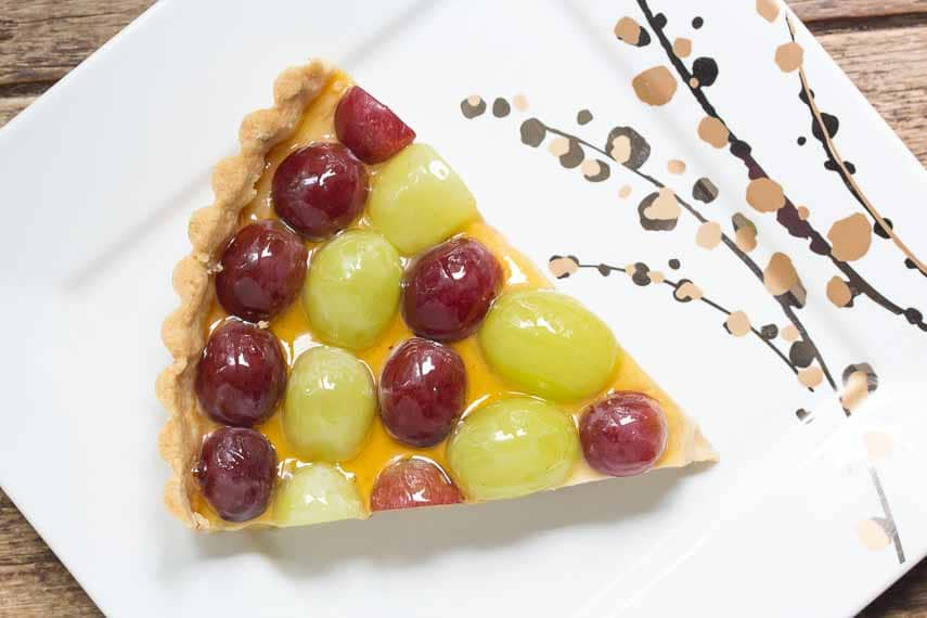 wedge of Fresh Grape Tart with Brown Sugar & Sour Cream Custard