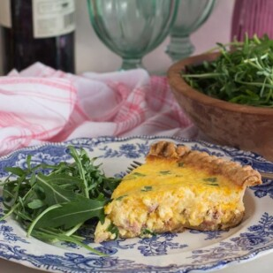 Ham & Cheese Low FODMAP quiche slice on a blue and white plate