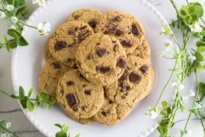 Low FODMAP Chewy Peanut Butter Chocolate Chunk Cookies on white plate; overhead image