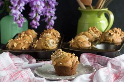 horizontal image of low FODMAP Peanut Butter Banana Muffins; on plate and in muffin pans