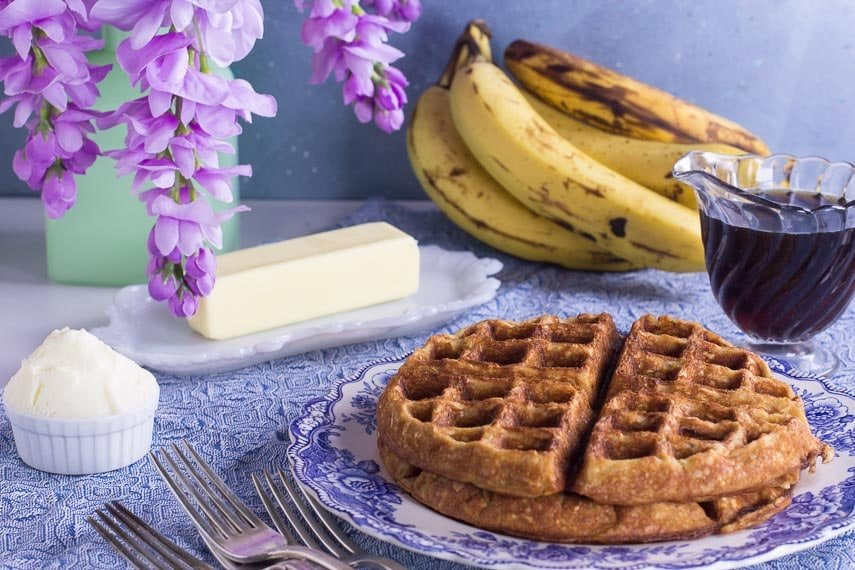 low FODMAP banana oat waffles against blue backdrop