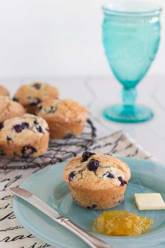 low FODMAP blueberry muffin, vertical image on aqua plate